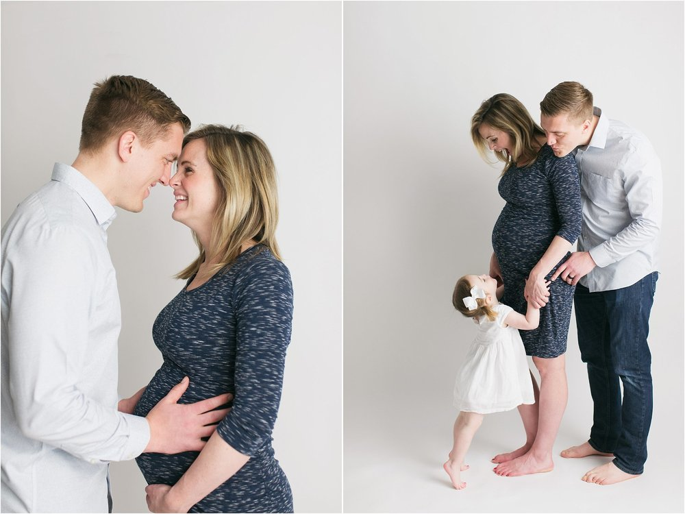 family maternity pictures big sister kissing belly