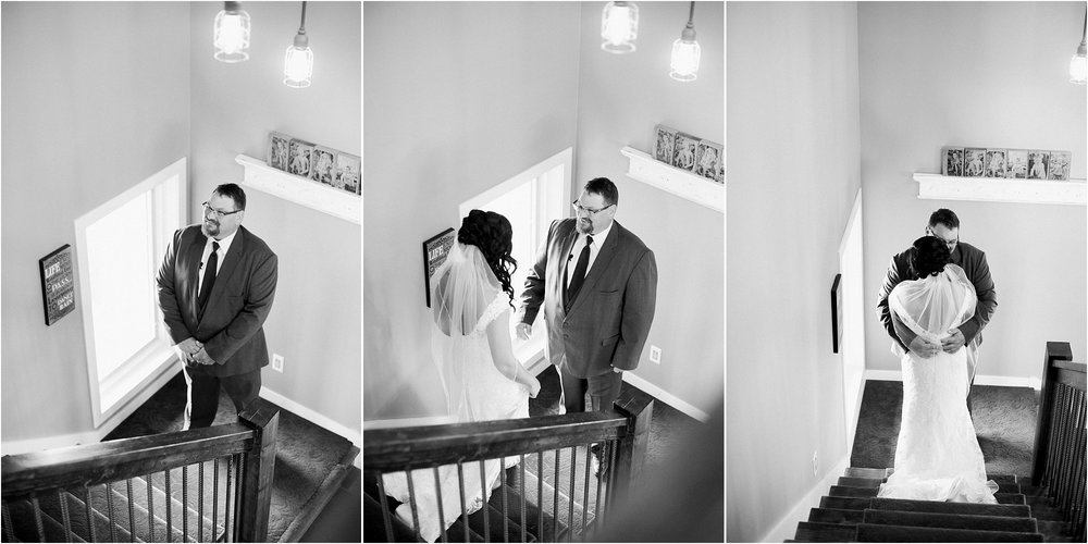 bride seeing her dad on her wedding day on a staircase