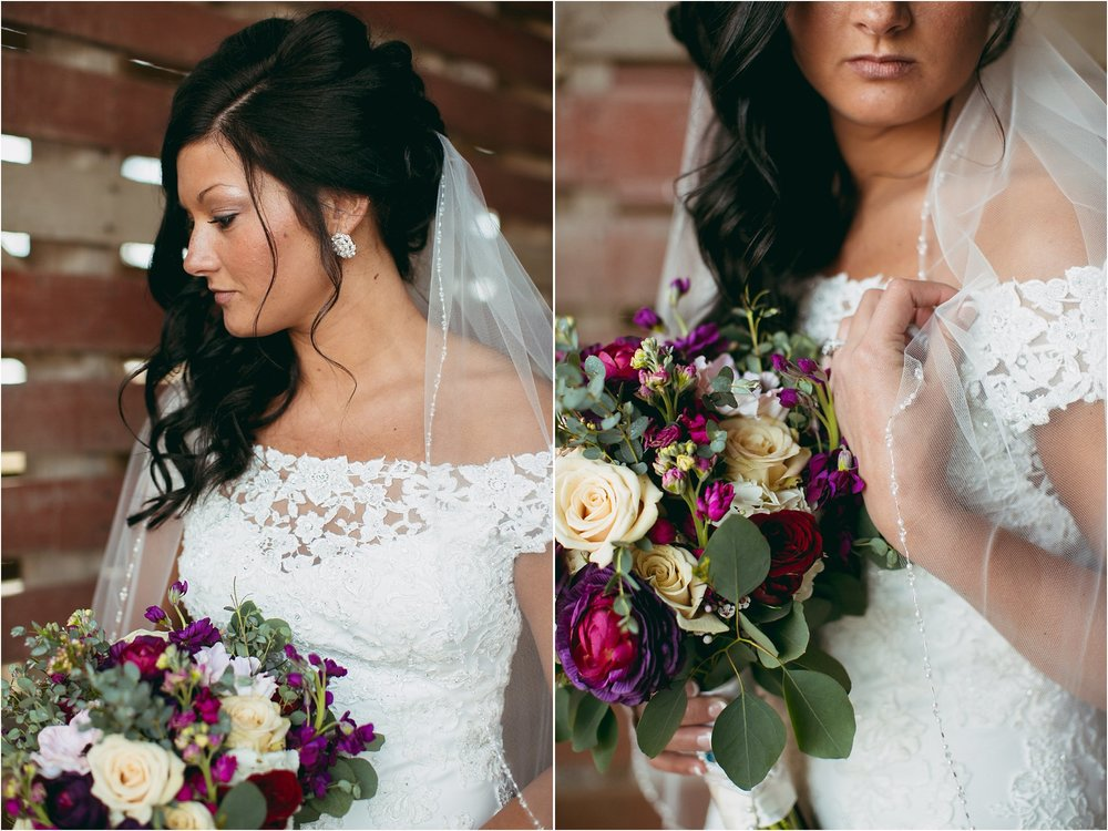 bride holding beaded veil with side hairstyle