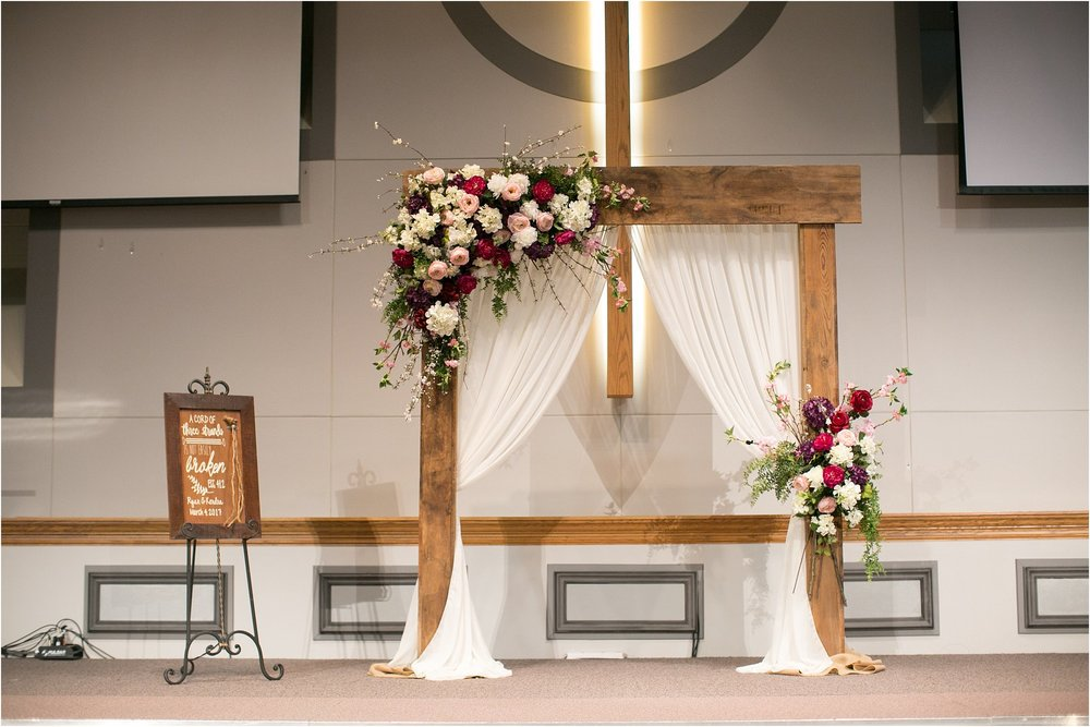 barnwood arch with floral sprays ceremony decor
