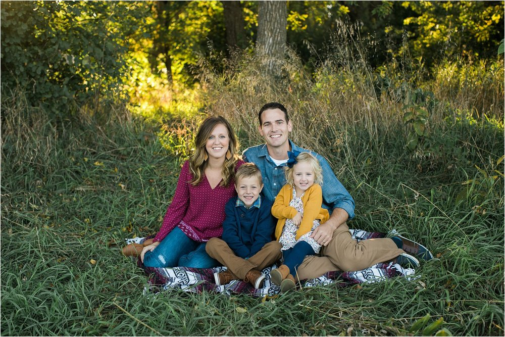 colorful fall family photo in tall grass