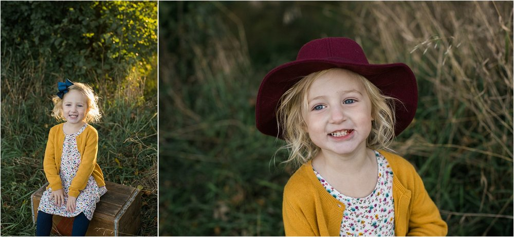 3 year old girl in maroon hat wearing a mustard cardigan