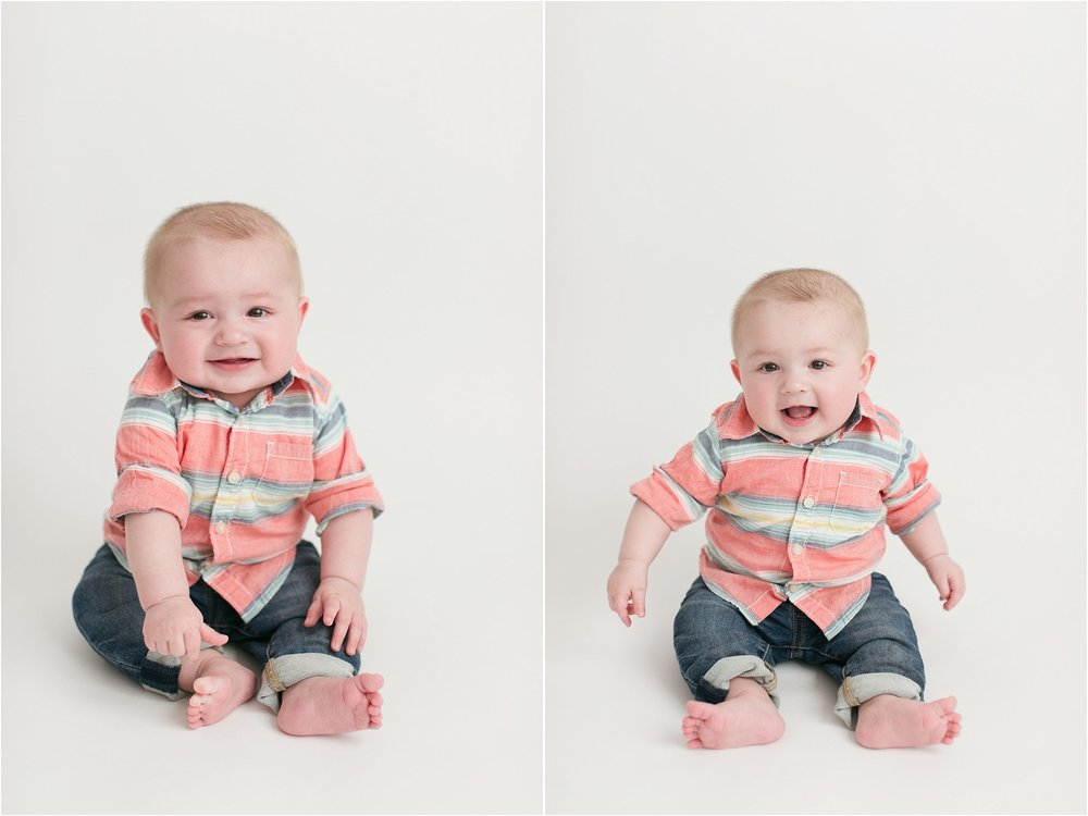 calvin 6 months old sitting on white backdrop