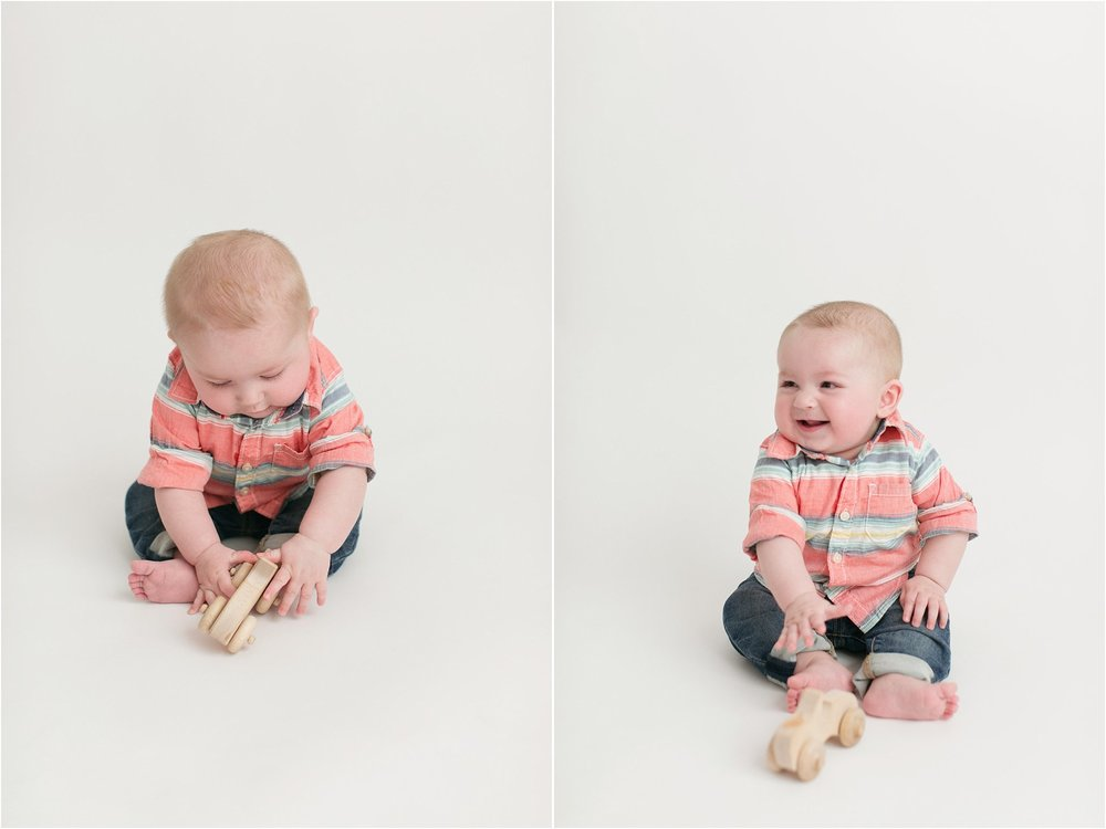 6 month old baby boy playing with wooden cars