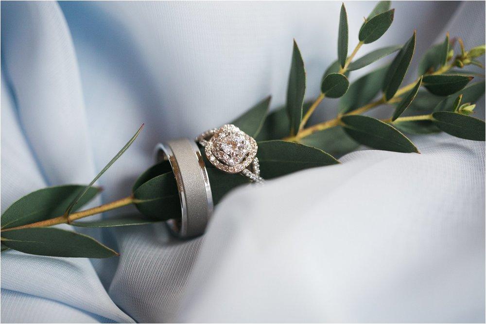 Wedding rings on light blue chiffon layer