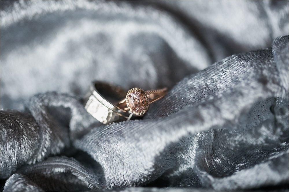 rose gold ring on dusty blue velvet fabric