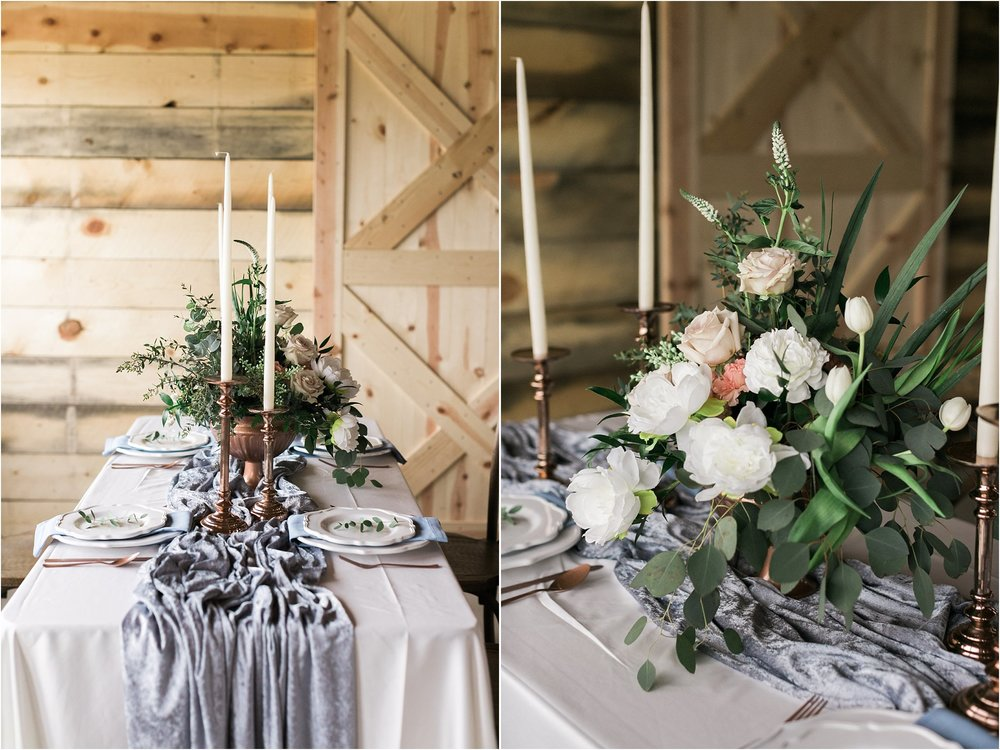 large floral centerpiece in a copper vase with candle sticks