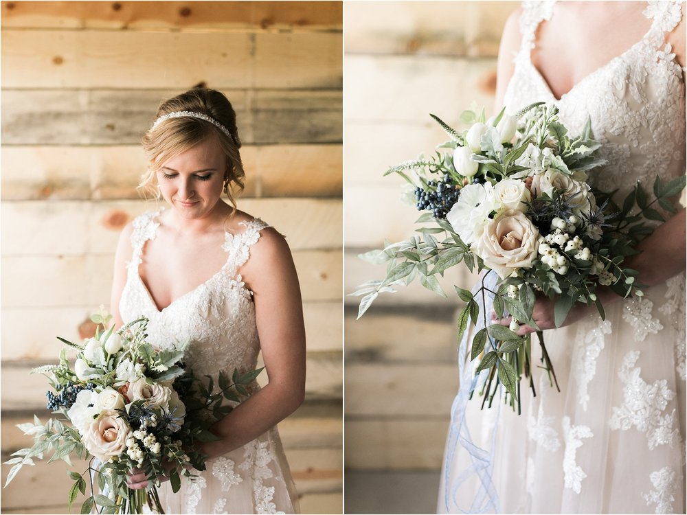 bride wearing lace dress with straps and gorgeous floral bouquet