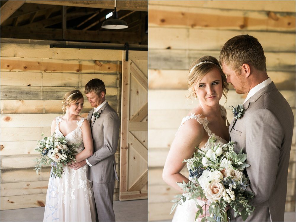 bride and groom wedding day portraits in a barn