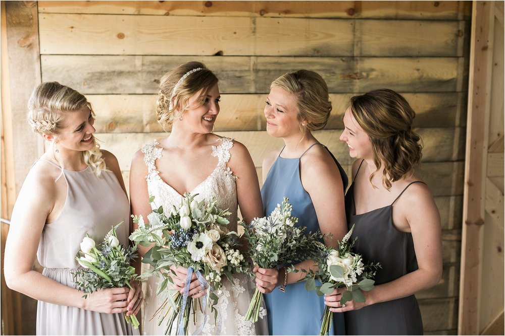 bride with bridesmaids in dusty blue and grey dresses