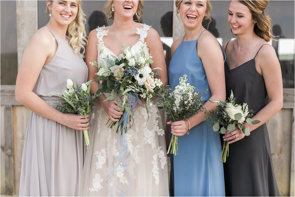 bride with her bridesmaids laughing