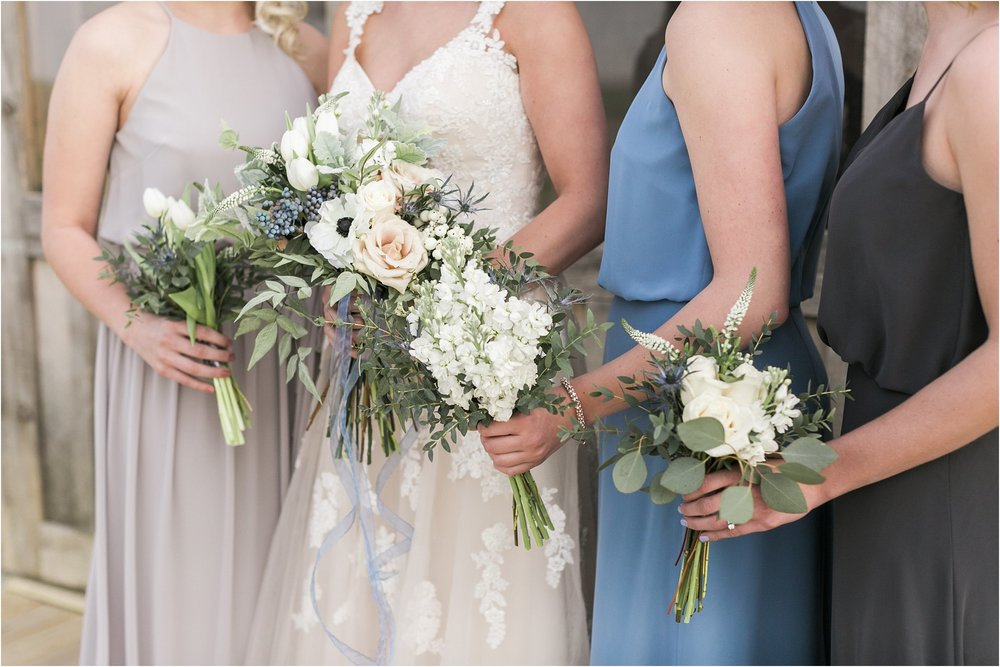 bride and bridesmaid bouquets with soft colors