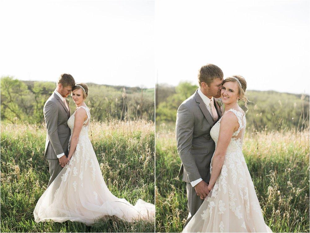 bride and groom holding hands groom kissing brides cheek