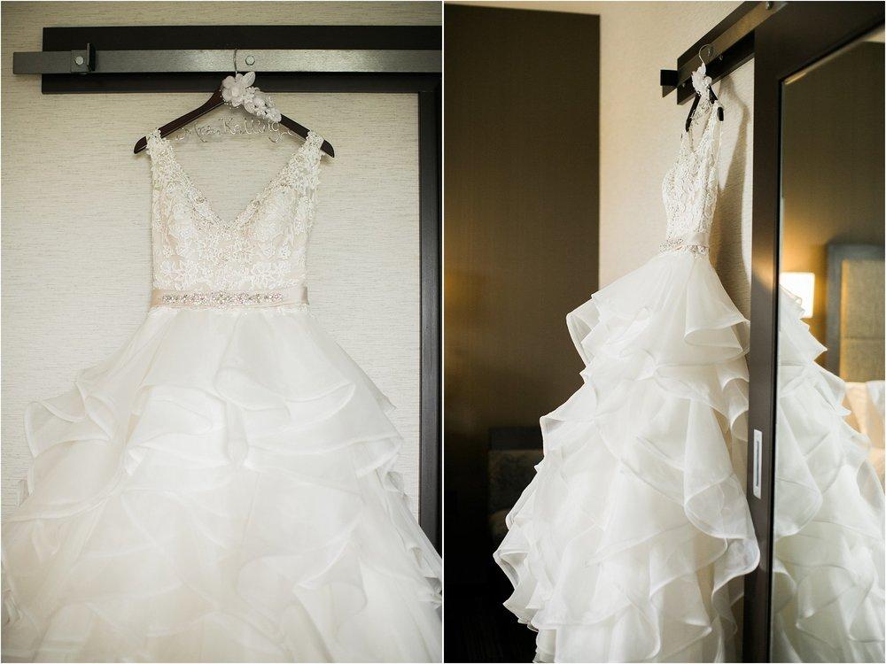 wedding dress hanging on sliding door with mirror