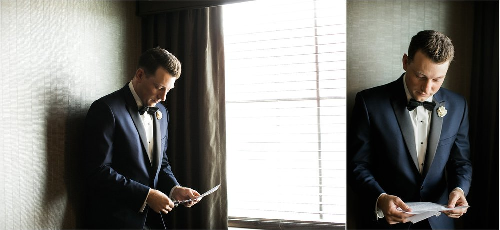 groom reading letter in hotel hallway