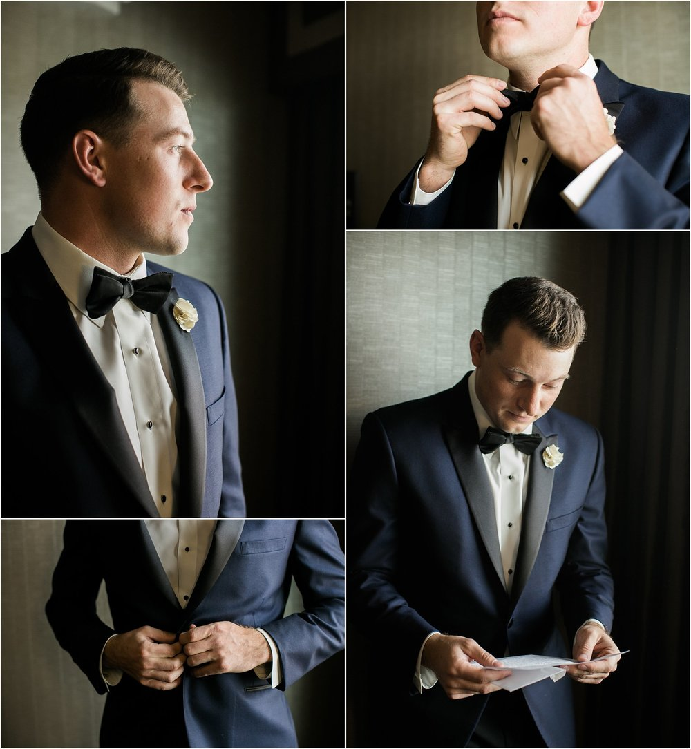 groom in navy suit with black lapels