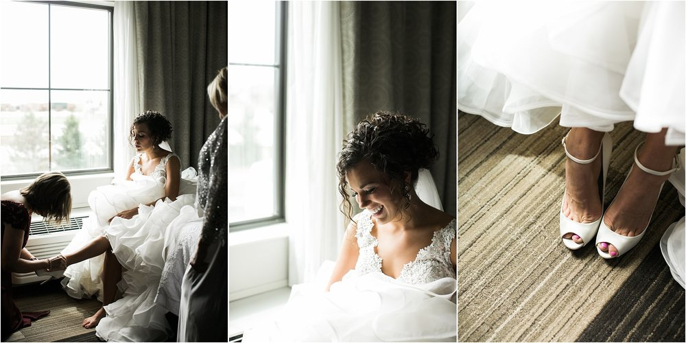 Mother of the bride putting on her wedding day shoes