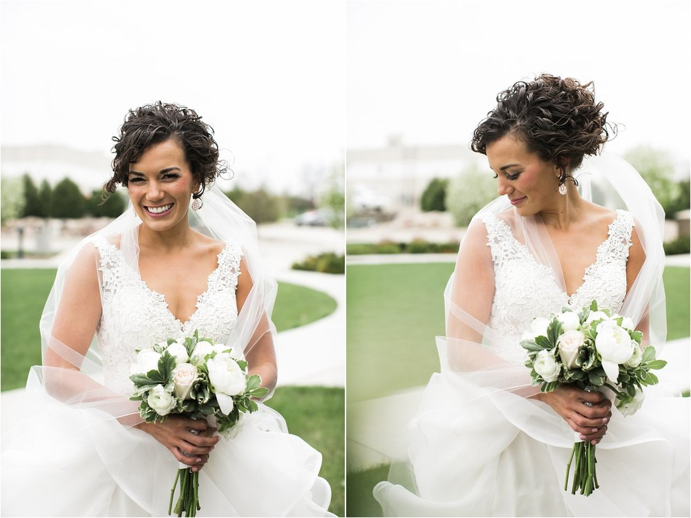 bride with dark curly hair and long veil