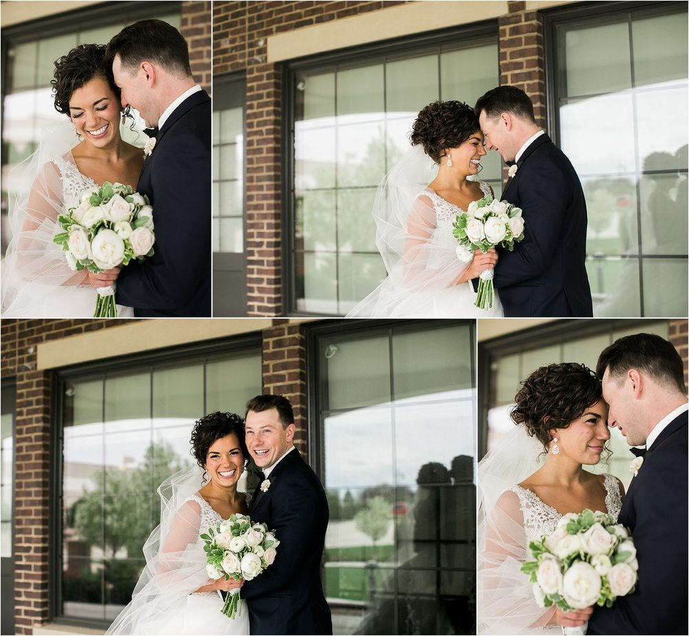 wedding couple in front of venue windows