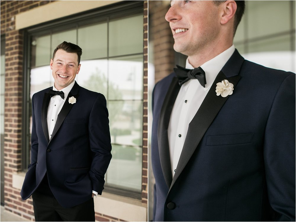 groom with navy blue and black suit