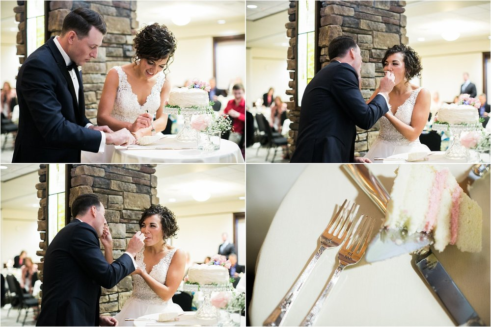 bride and groom cutting cake with personalized forks