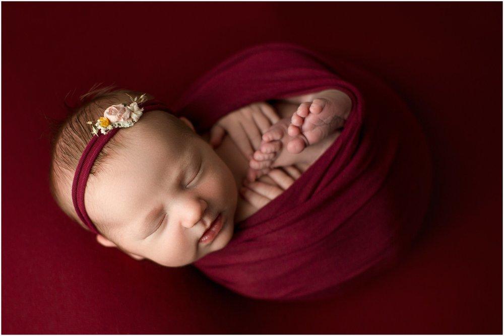baby girl suttyn on raspberry backdrop