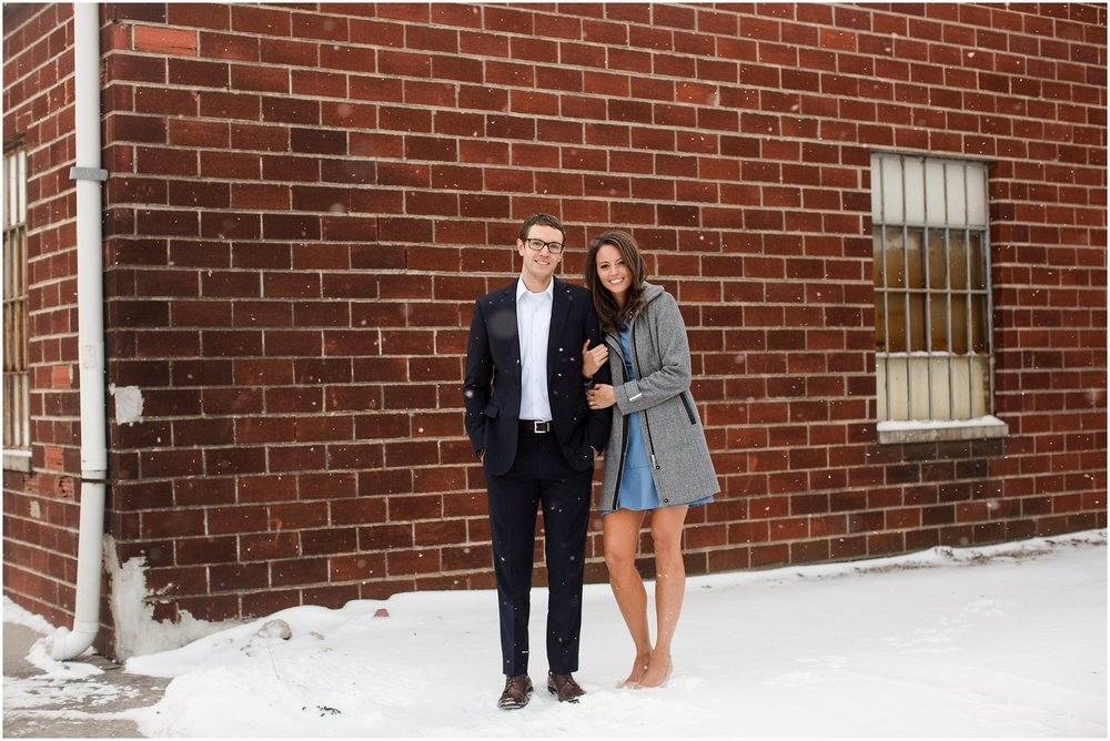 winter engagement session in blue dress and suit
