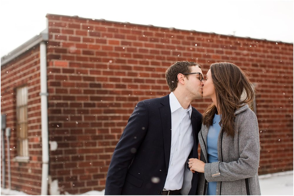 couple leaning in for a kiss with snowflakes