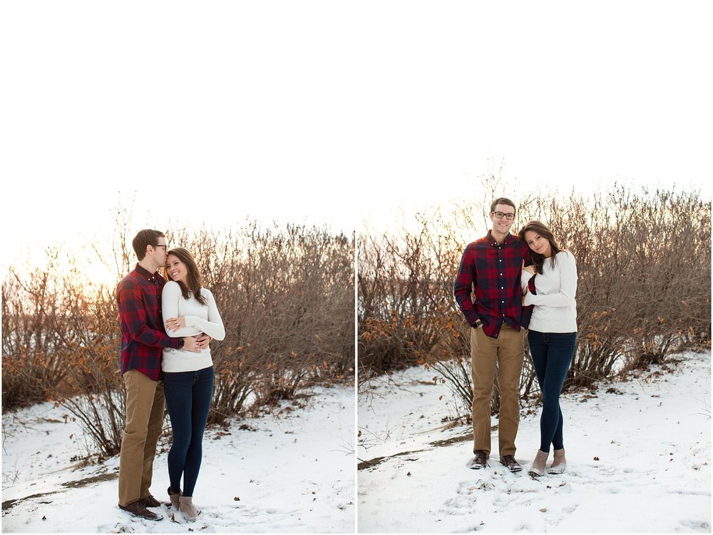 couple snuggled up wearing flannel in snow