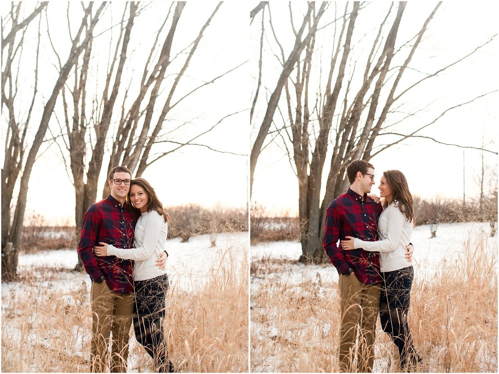 couple cuddling up in tall grass during winter