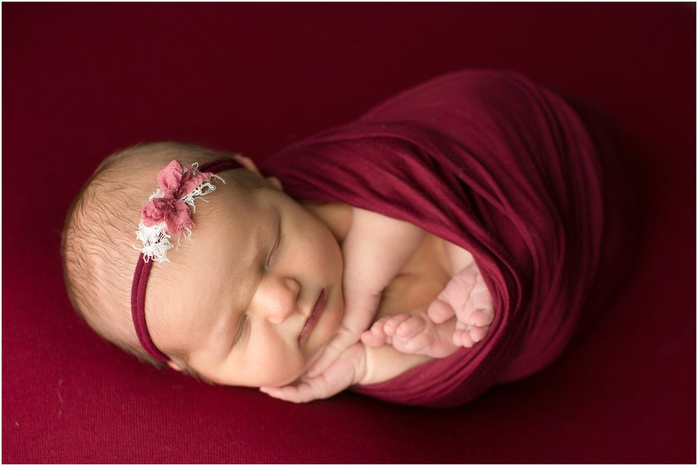 baby girl wrapped in raspberry wrap