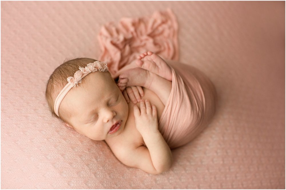 evelyn rose wrapped on pink blanket