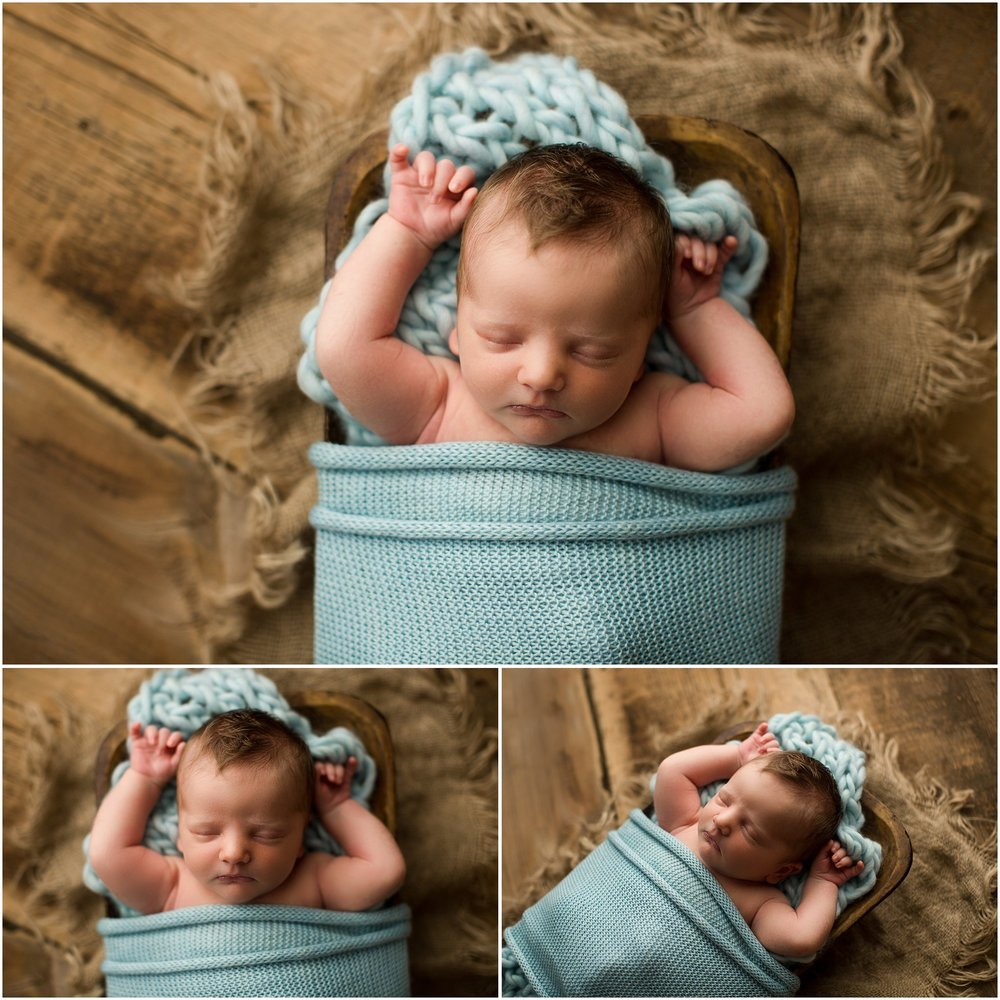 sleeping newborn boy in light blue