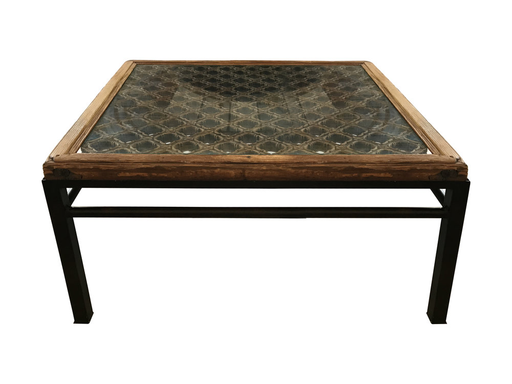 The core of this coffee table is an antique Chinese screen.