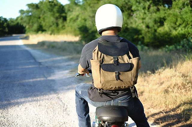 The Pecan Dyed Canyoneer Rucksack looking good on the open road.  #handmade #naturallydyed #waxedcanvas #leather