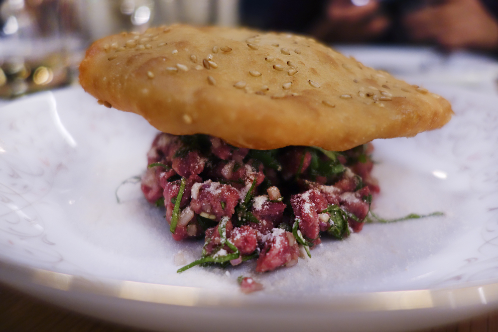 Prime beef hanger steak tartare, larb seasoning, sesame bread
