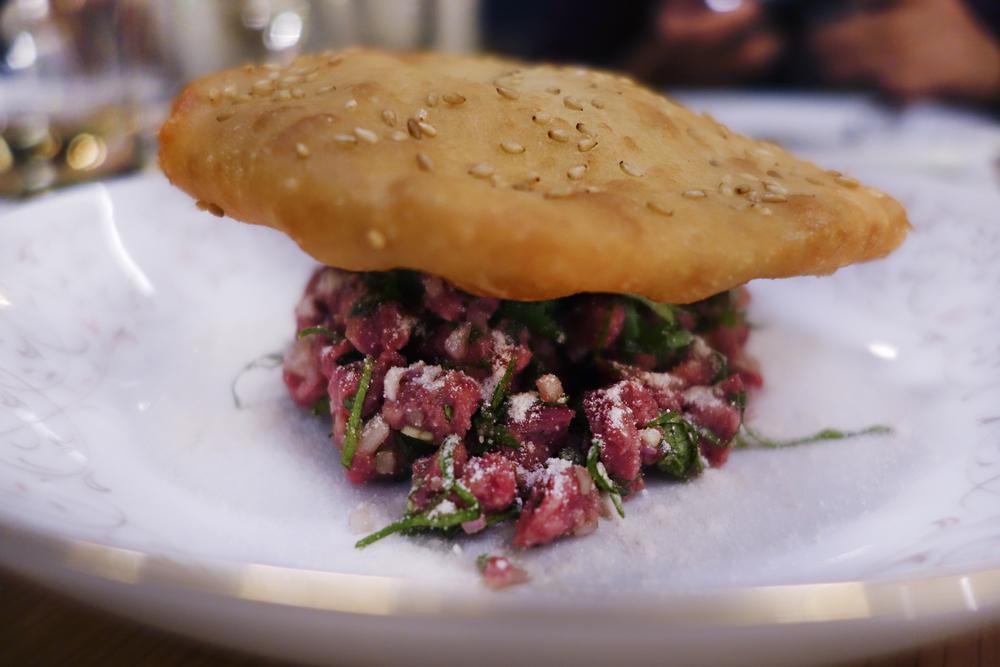 Prime beef hanger steak tartare, larb seasoning, sesame bread