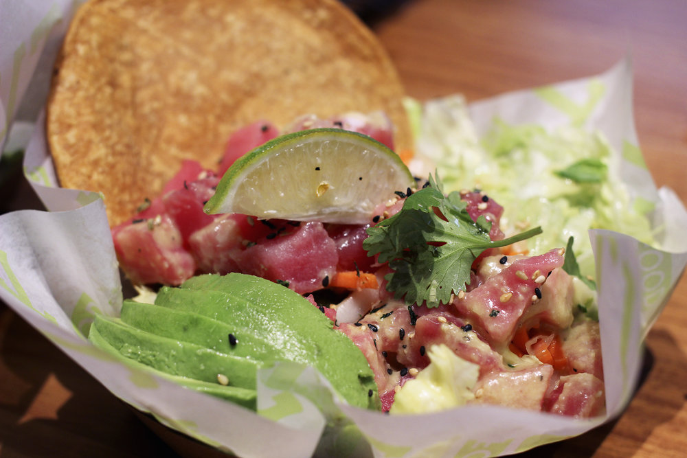 Ahi Tuna Tostada - Tostada with Sushi Grade Ahi, Garlic Ginger Dressing, Pickled Veggies, Avocado, Lime, Cilantro, Iceberg & Sesame Seeds