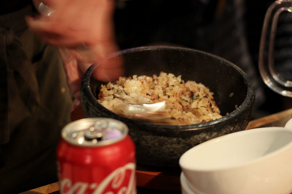 Garlic Rice - Garlic Fried rice with pickles in a stone pot.