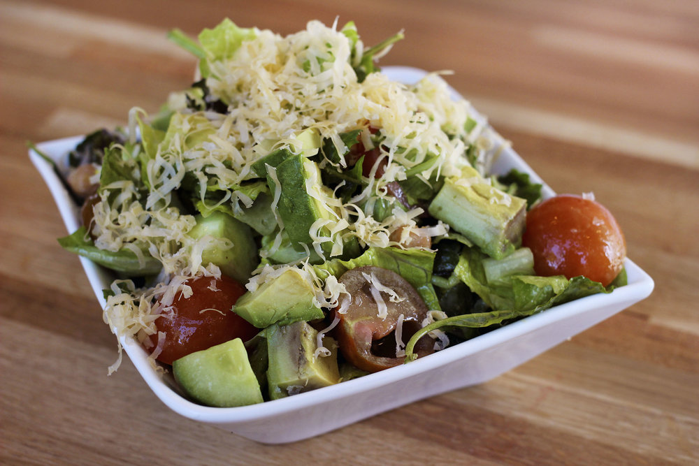 Chop Houz (VG) -  Chopped Baby Romaine & Kale, Heirloom Tomatoes, Chickpeas, Red Onion, Fresh Herbs, Cucumbers, Avocado, Honeyed Walnuts, Topped with Premium Aged Cheddar Served with Chive-Honey-Dijon Dressing. Refreshing and delicious. The Aged Cheddar added a nice nutiness to this salad.
