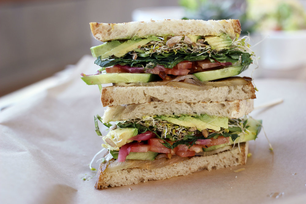 Zen - Kale, Cucumber, Toasted Sunflower Seeds, Avocado, Sprouts, Pickled Red Onions, Roma Tomatoes, Roasted Pears, Vegan Potato Roll (Got sourdough instead). You may not believe me, but this is probably one of the best sandwiches I've had. Simple does not do justice to how balanced the flavors were. No dressing was needed as the roasted pears added an extremely sweet round flavor complimented by the tartness of the pickled red onion. The toasted sunflower seeds added the perfect texture you would want in this sandwich. I would order this again, hands down.