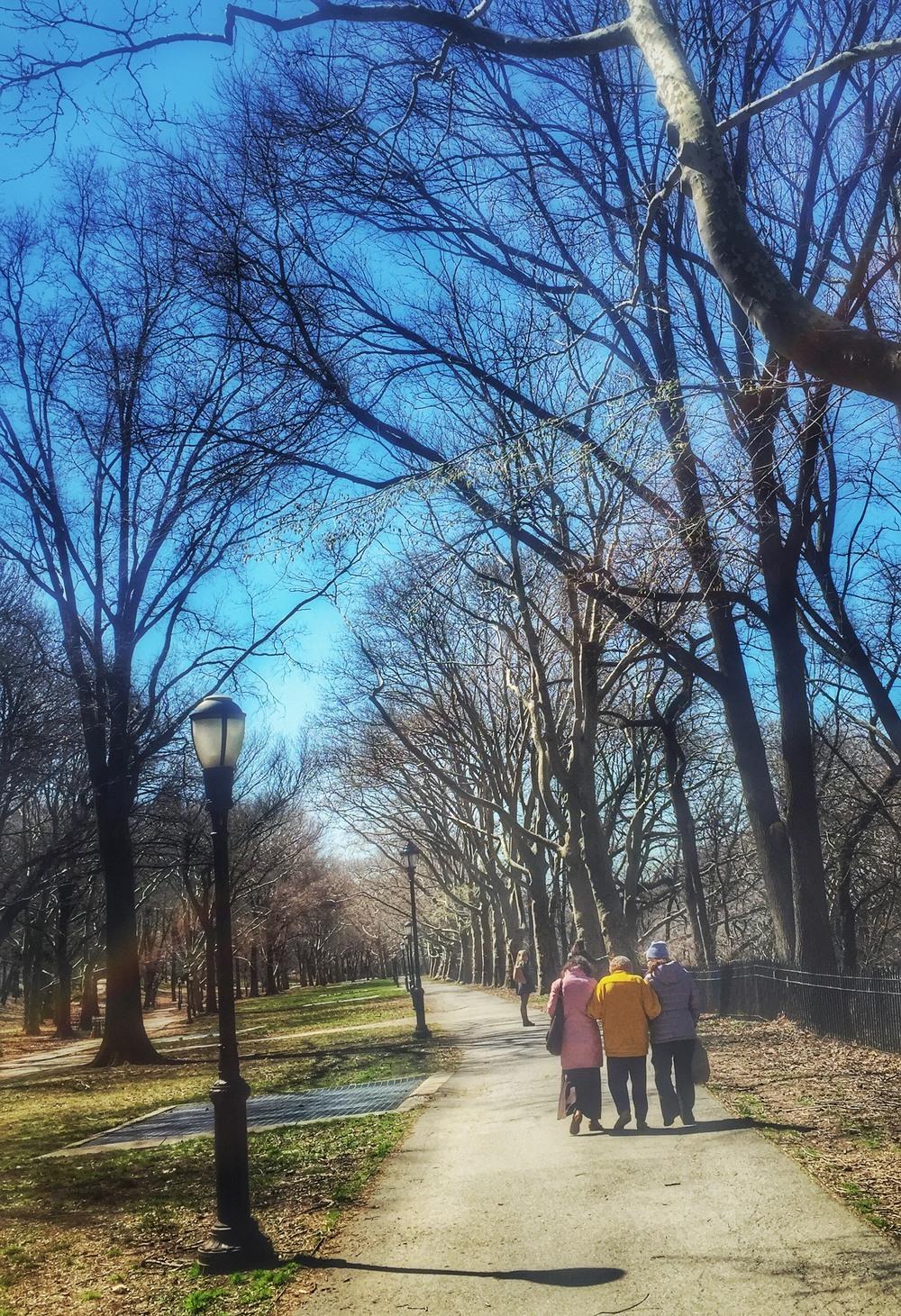 Three women walking. Riverside Park, April 2016.