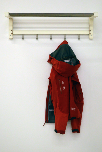 Arc'teryx Jacket / TJUSIG Hat Rack (2014), Lexie Owen Textile, wood, metal Image courtesy of the artist