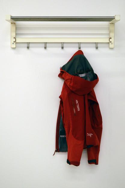 Arc'teryx Jacket / TJUSIG Hat Rack (2014), Lexie Owen Textile, wood, metal Image courtesy of the artist