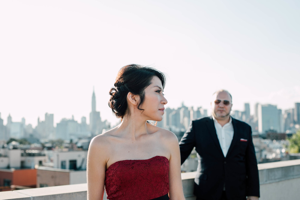 outdoor engagement session with a skyline view
