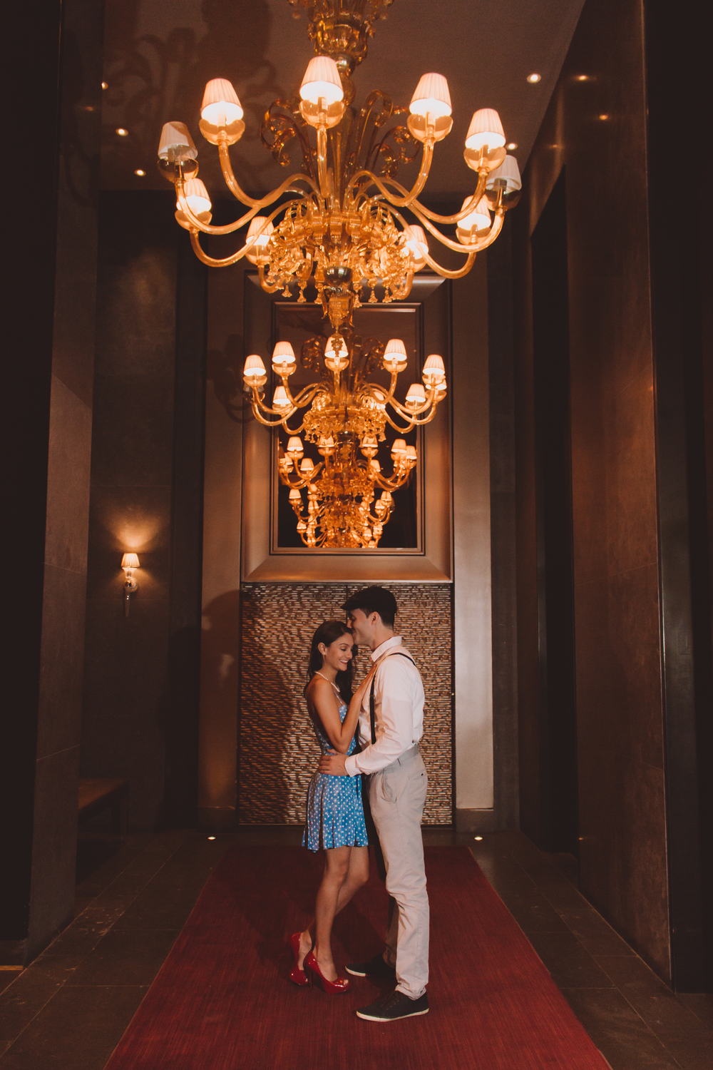 red carpet chandelier engagement photography