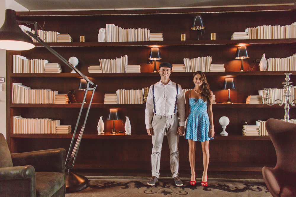 couple standing in front of bookshelf