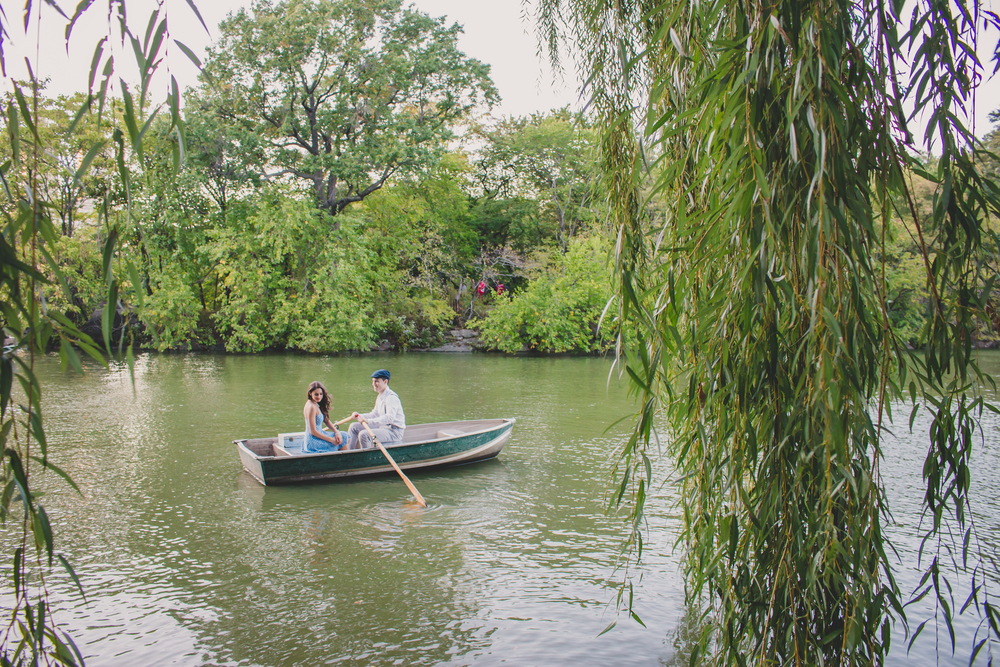 central park nyc engagement session on rowboat