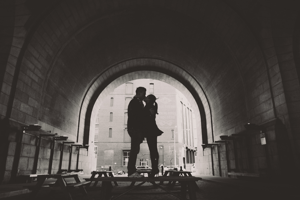 Dumbo black and white engagement photos in archway