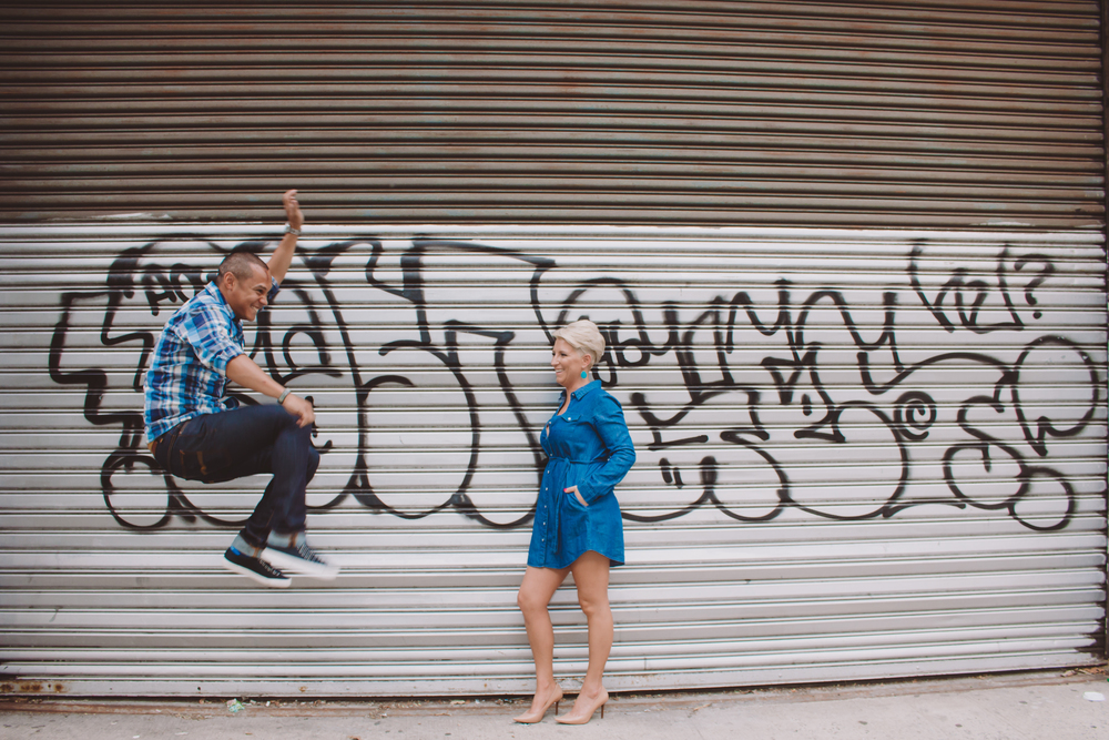 fun jumping pose nyc wedding photos